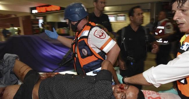 The Latest: Israeli leader condemns mob attack on Eritrean