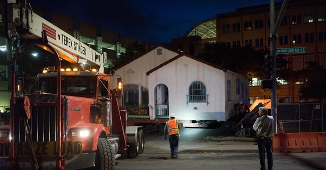 Tiny Oakland house moved down street after owner's death