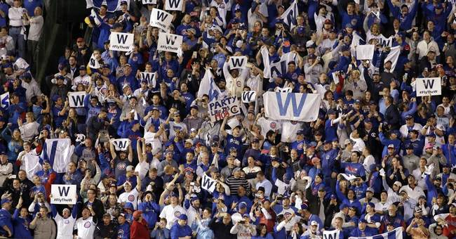 Chicago Cubs fans Fly the W as long as they can