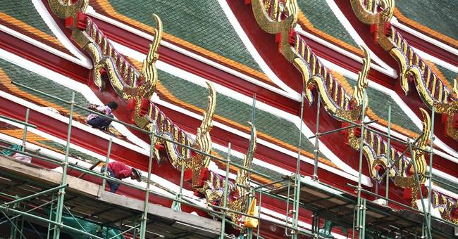 Image of Asia: Renovating distinctive roof of a Thai temple