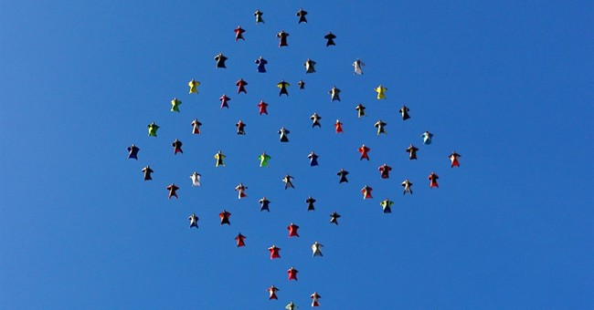 61 wingsuit skydivers set formation record over California