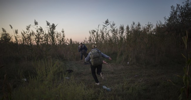 AP Photos: A Syrian's journey to new life in Europe