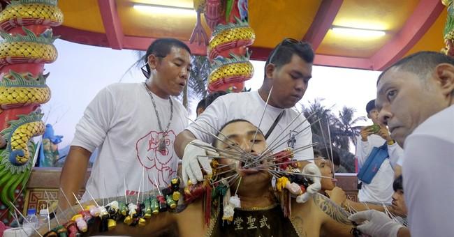 At Thailand veggie festival, only flesh of the devout harmed