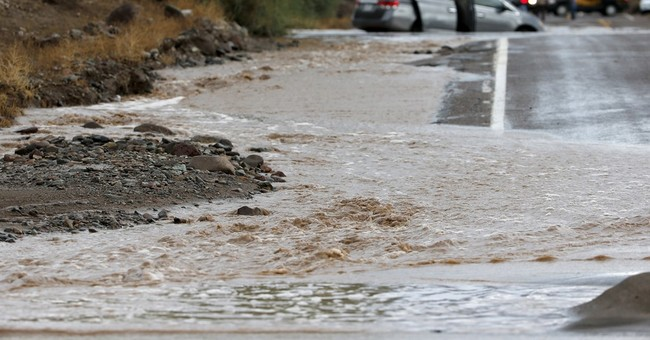 Woman rescued as storms pelt Southwest; El Nino on the way