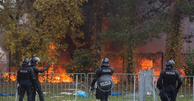 'Let us go!' Migrants ford icy river, burn tents in Slovenia