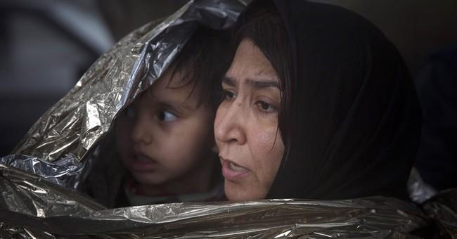 The Latest: 2,000 migrants headed toward Austria in 4 trains