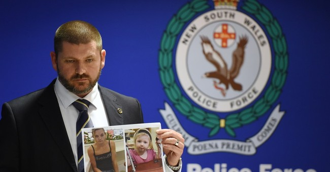 Australian police link body in suitcase to body in forest