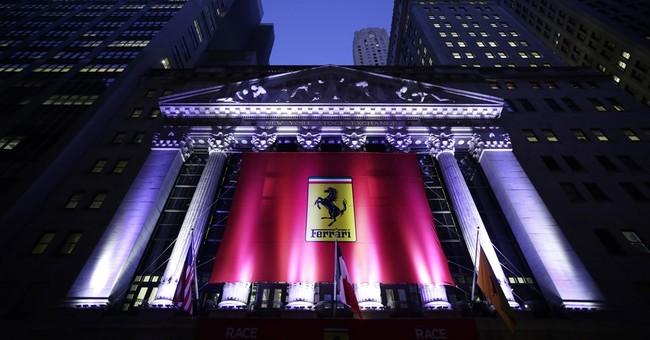 Asian stocks mostly lower on weak Wall Street lead, earnings