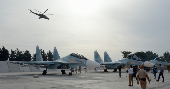 Russia shows military might in Syria, also pushes diplomacy