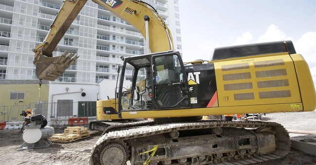 Caterpillar weighed down by slowing global economic growth