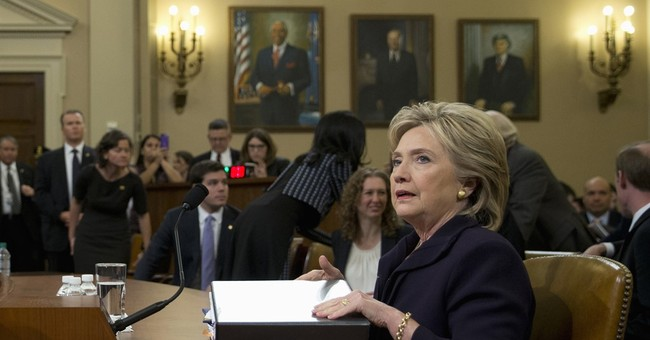 Analysis: Clinton tries to rise above fray in Hill hearing