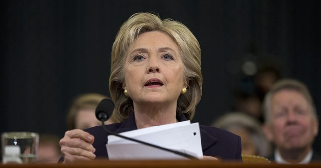 Under GOP grilling, Clinton seeks to close book on Benghazi