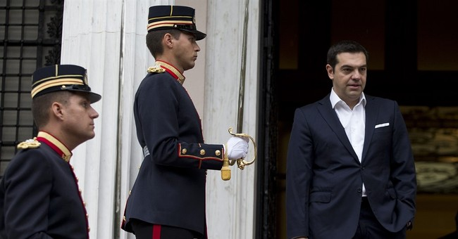 France supports Greek request to discuss easier debt terms