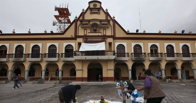 In frightened Mexico town, a mob kills 2 young pollsters