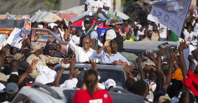 Aristide makes rare public appearance for Haiti elections