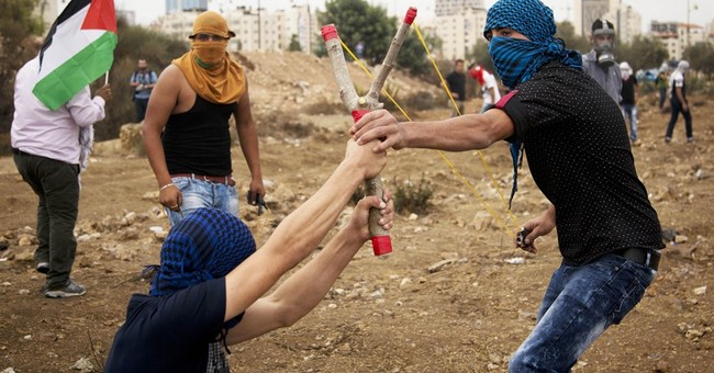 The Latest: Israel says Palestinian stabber shot dead