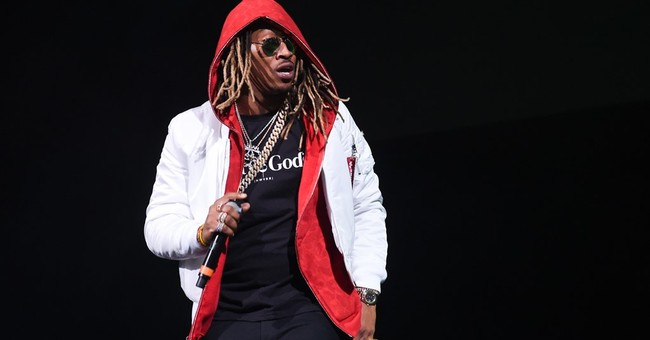 Injured but energetic Fetty Wap performs from seat at show