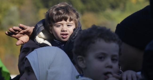 Refugees flood into Slovenia; EU migrant plan criticized