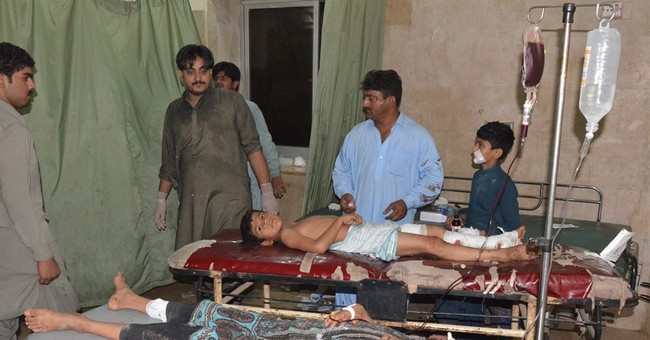 Pakistani Shiites demand protection after bombing killed 18