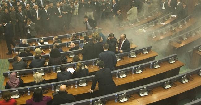 Police, protesters clash overnight in Kosovo