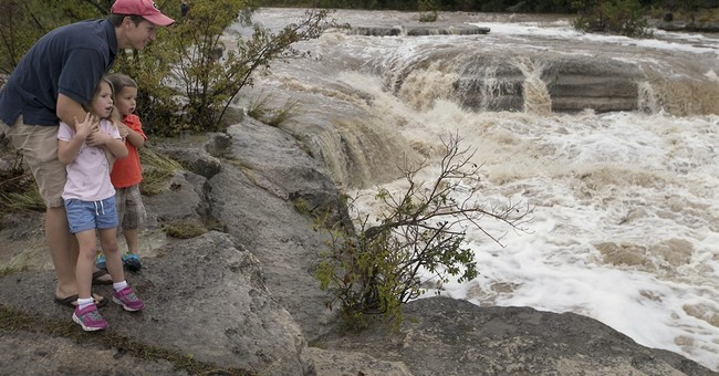 The Latest: Texas man swept away in flood found alive