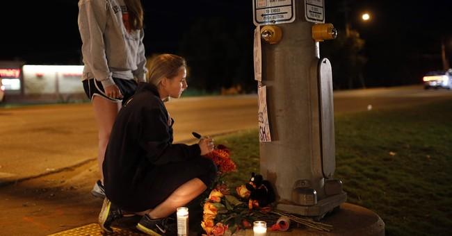 The Latest: Vigil at Oklahoma State honors victims of crash