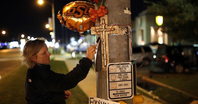 The Latest: Vigil at Oklahoma State honors victims of crash