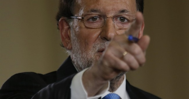 Spain's PM calls Dec. 20 elections, lauds government record