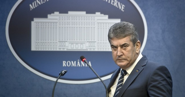 Romania interior minister: I didn't know police officer died