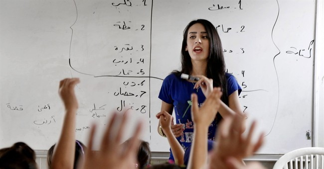 Classes swell in Iraq camps as teachers leave for Europe