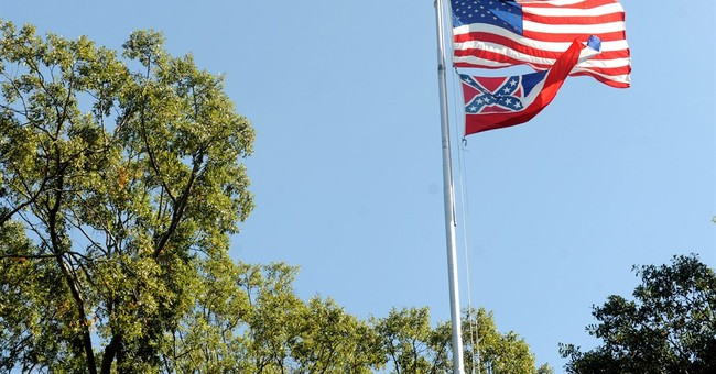 Ole Miss removes Mississippi flag with Confederate emblem