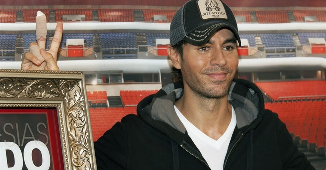 After hand surgery, Enrique Iglesias helping kids in crises