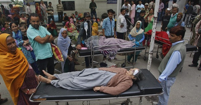 Rescue work expands in quake-hit Pakistan, Afghanistan