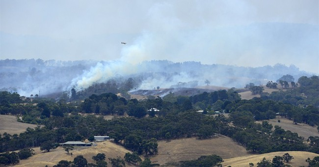 Australian wildfire threat eases as cool front moves in