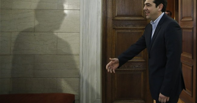 Greek leader tamps down rhetoric, vows to pay  off debts