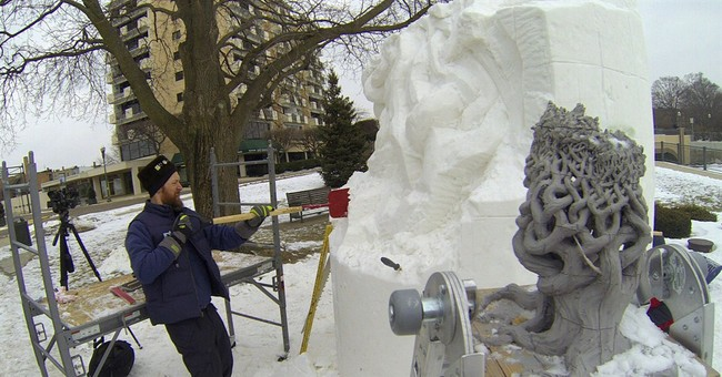 Wisconsin team works to defend snow sculpting championship