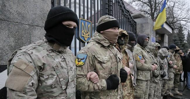 Artillery fire kills at least 12 civilians in Donetsk
