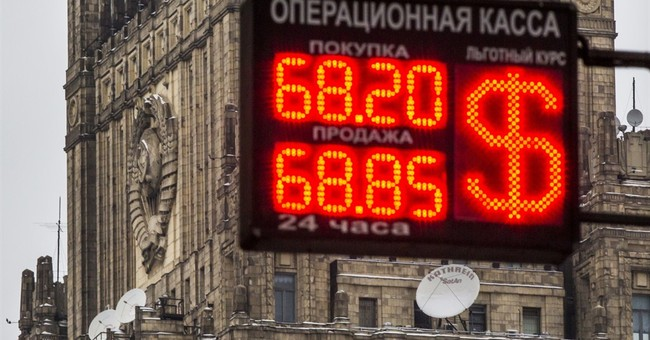 Russia cuts key rate to help economy, leaving ruble to drop