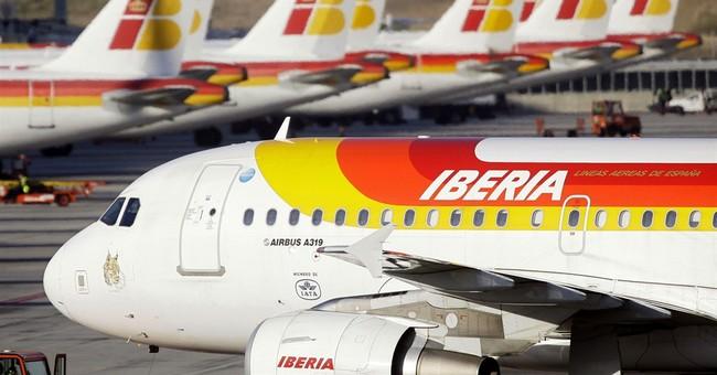 Qatar Airways buys nearly 10 percent of BA, Iberia parent