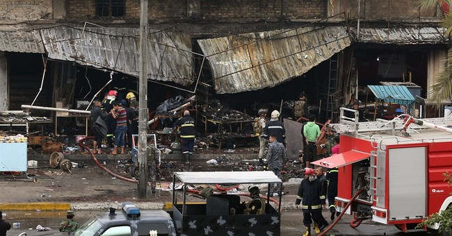 Officials say bombings kill 14 people around Iraq's capital