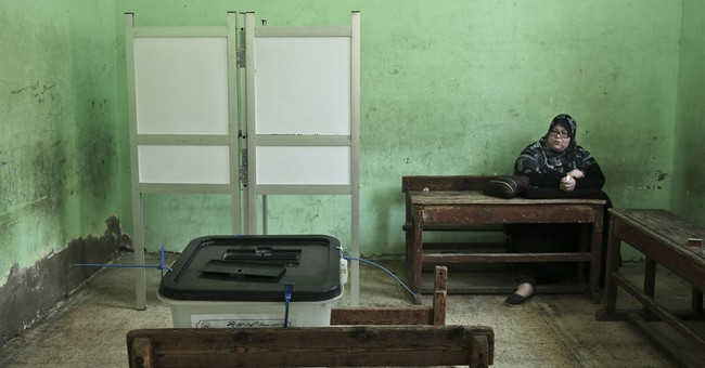 Egyptians trickle to polls in parliamentary runoffs