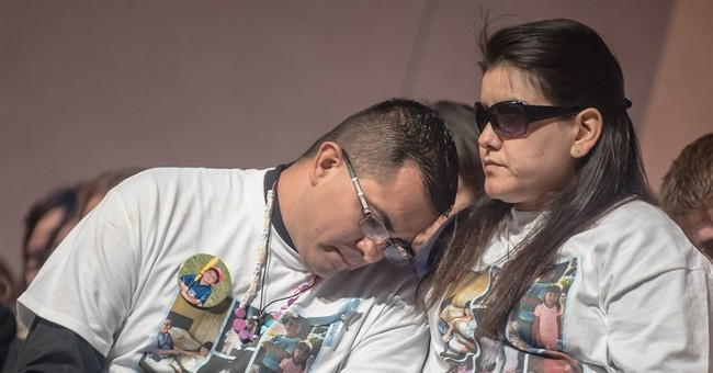 At funeral, white and blue coffin, memories of girl's smile