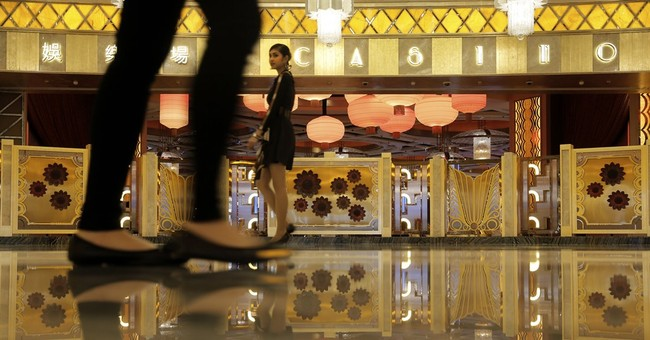 Macau opens Hollywood-themed casino resort as slowdown bites