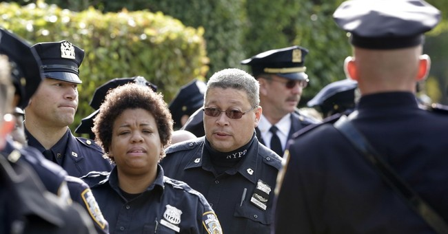 Officers weep at wake for NYC policeman shot in head on duty