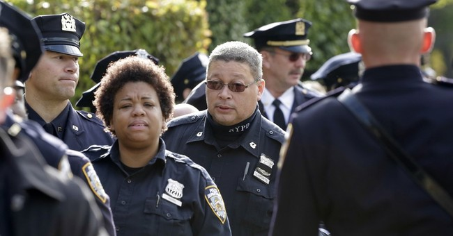 Funeral of slain New York City officer draws thousands