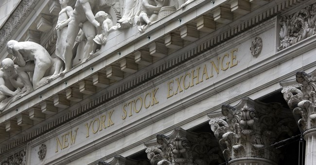 Stocks tick lower on mixed earnings; price of oil skids