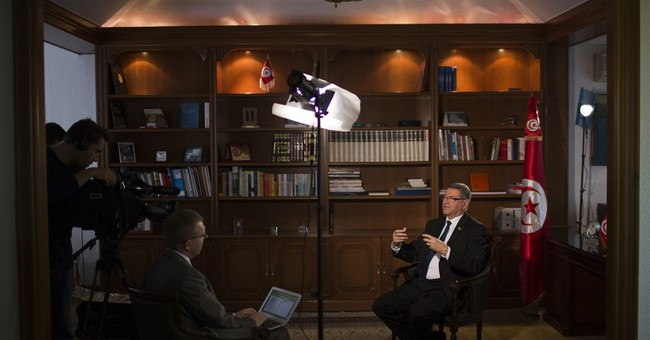 AP Interview: Tunisia PM says jobs needed to counter terror