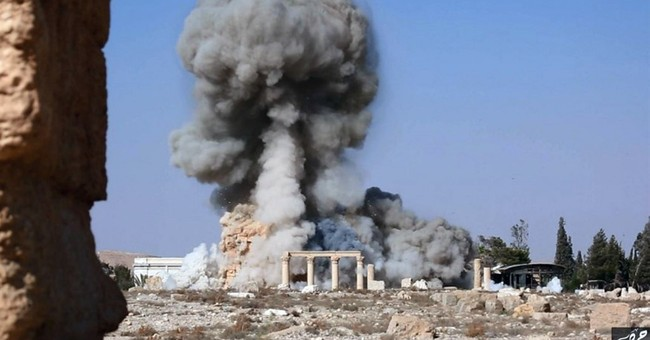 IS militants tie captives to Palmyra columns, blow them up