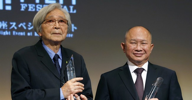 Surprised by award, Woo says he's just hard-working director