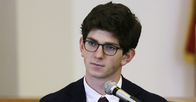 The Latest: Prep school grad to remain free during appeal